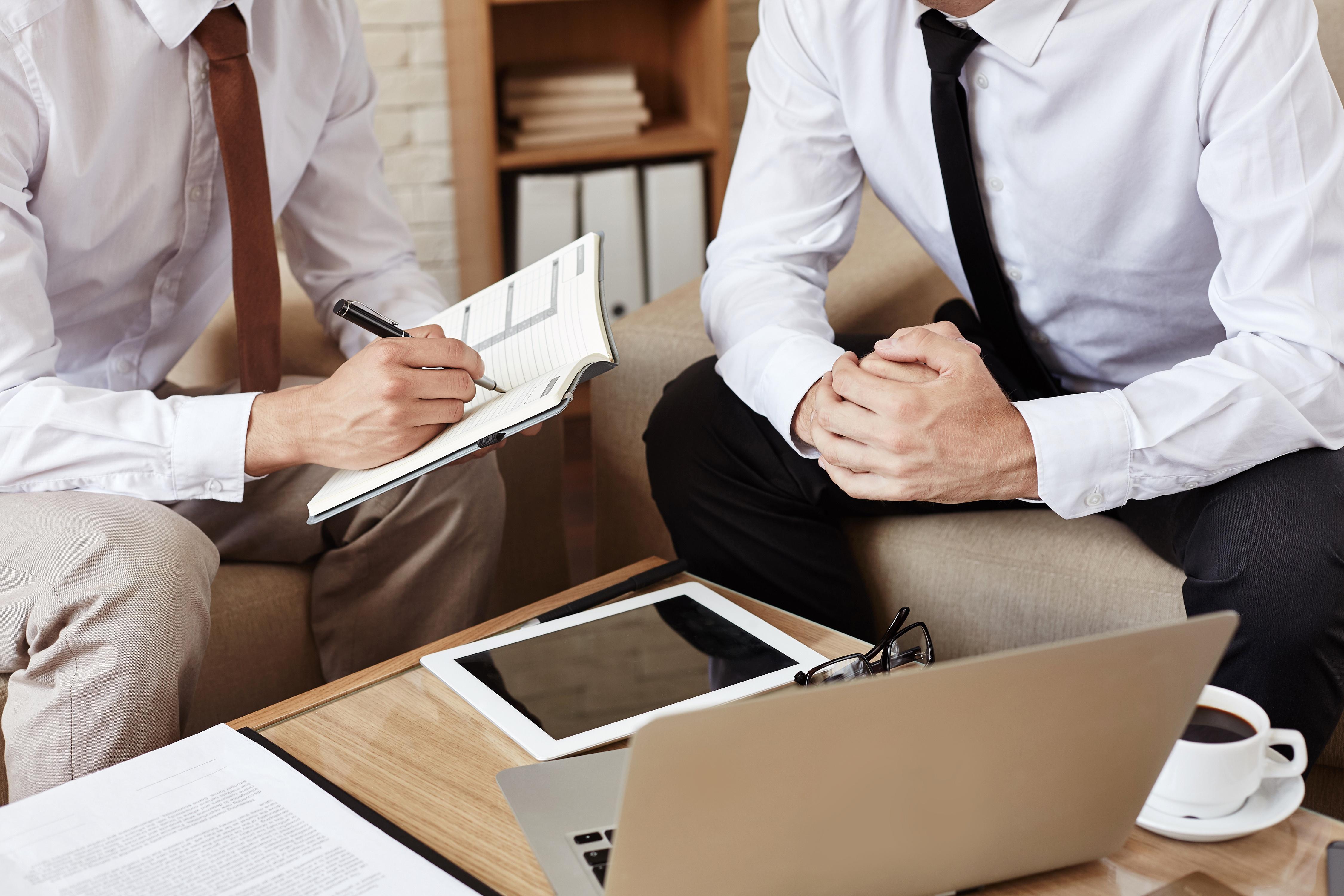 businessmen-at-meeting-P4M4QFV