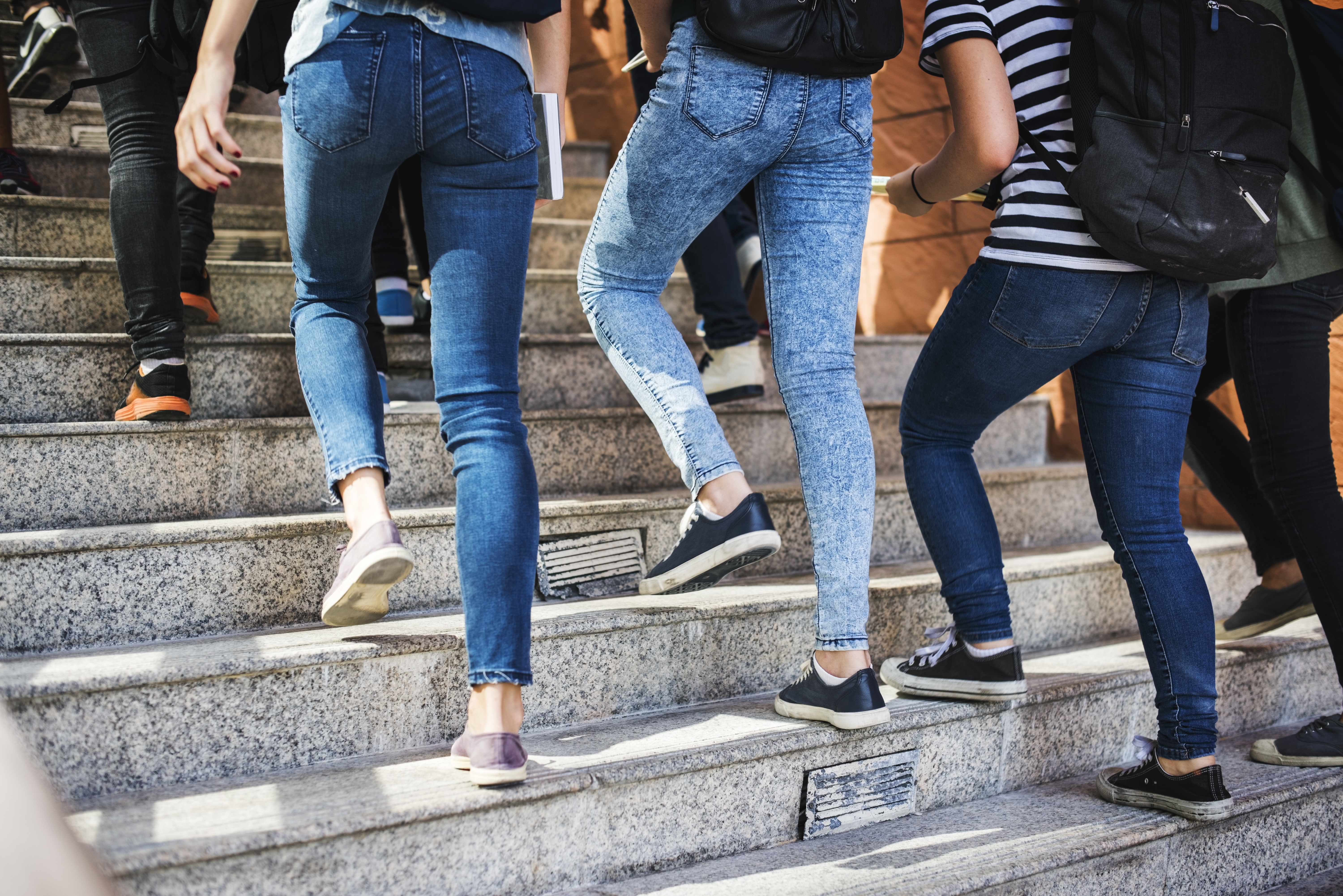 students-walking-up-on-staircase-P5JLS3D